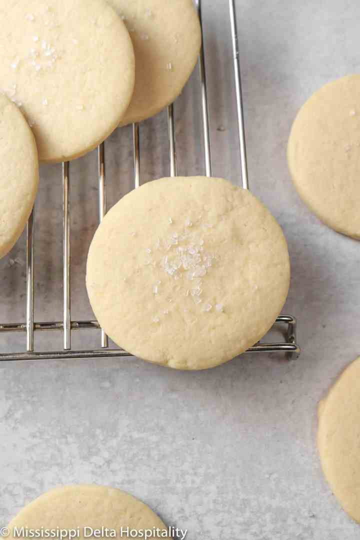 sugar cookies on a cooking rack with white sugar on top