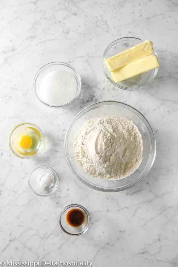 ingredients for sugar cookies in glass bowls