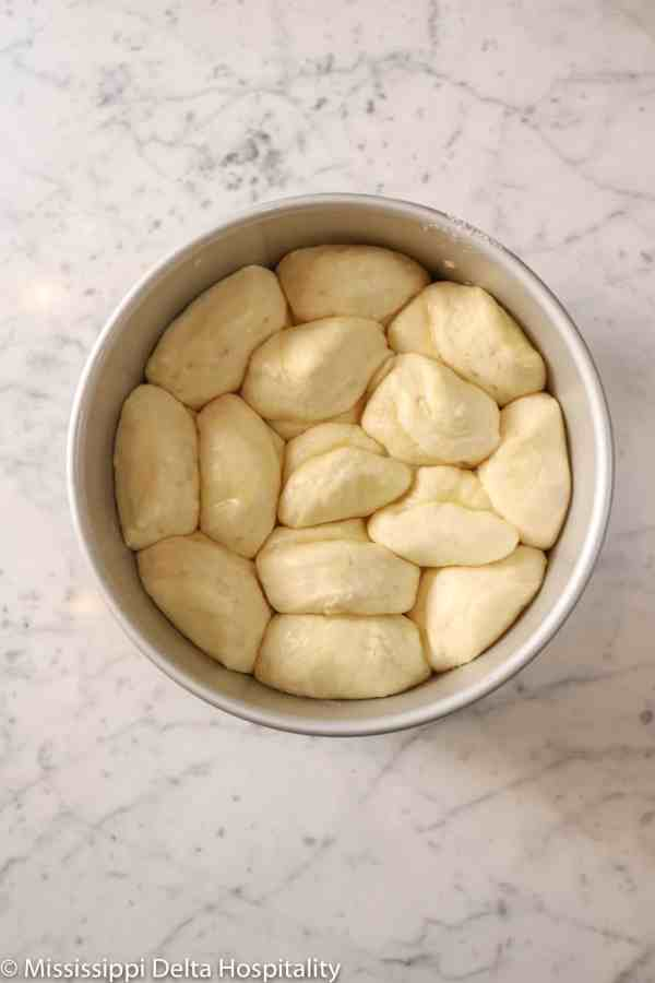 rolls doubled in size in a circle baking pan