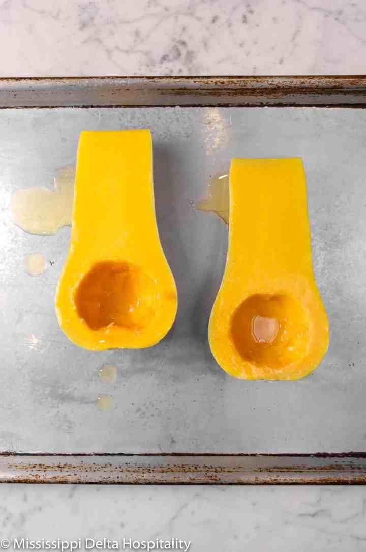 olive oil drizzled onto butternut squash halves