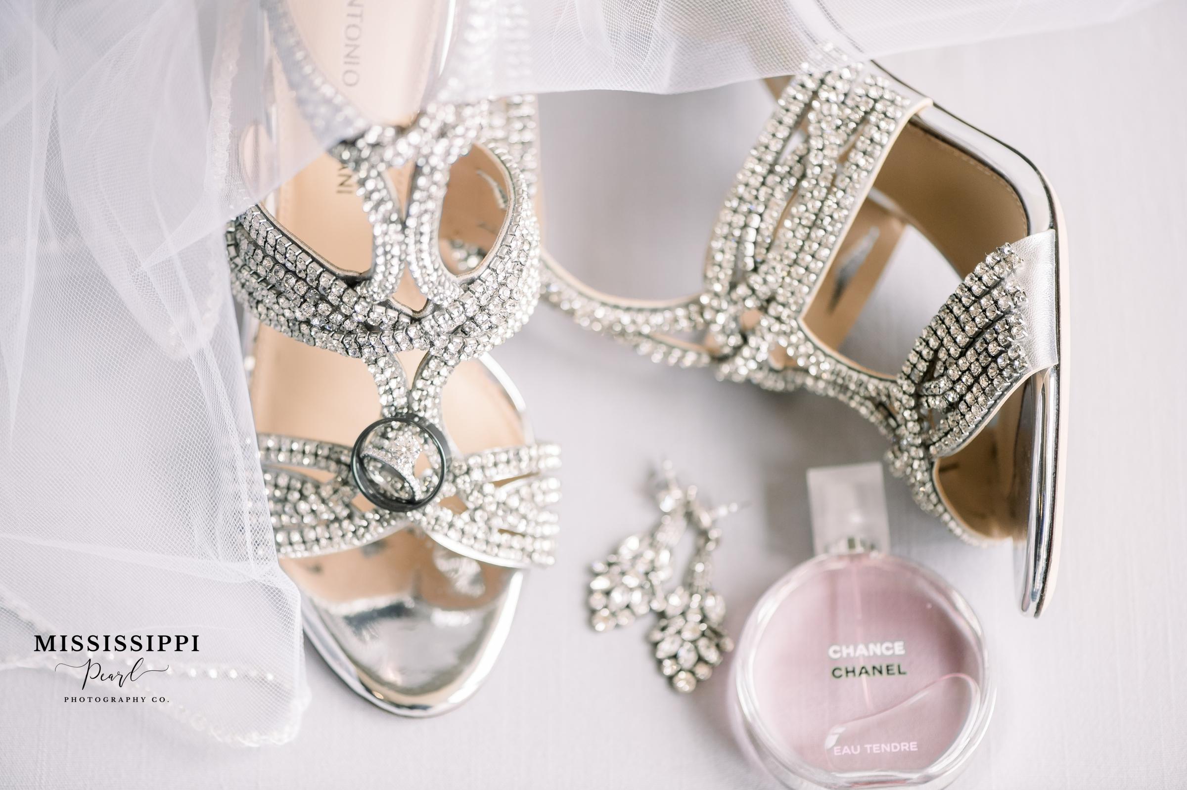 Wedding heels with Chanel perfume bottle, earrings and wedding rings