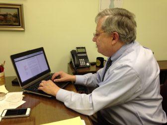Chancellor Larry Primeaux works on his blog