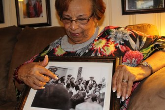 Flonzie Brown-Wright, Veteran of the Civil Rights Movement in Mississippi points to a photo of herself introducing Dr. Martin Luther King, Jr on the steps of the courthouse in Canton, Miss.
