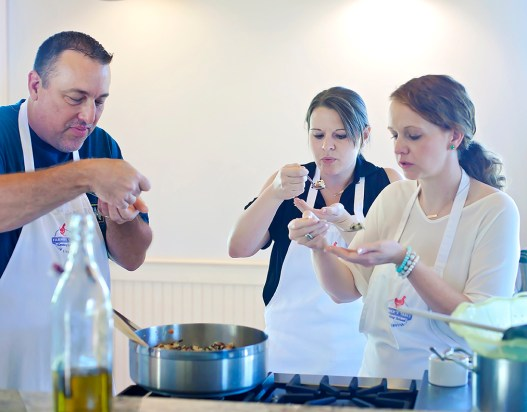 Cooking students, from left, Barry Ypya, Ann Marie McGee and Helen Ann Campbell taste the wild rice they prepared Tuesday, June 7, at the Farmer's Table Cooking School in Livingston.