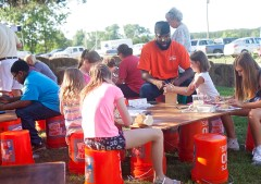 Children make their own crafts at the Home Depot kids workshop at the Livingston Farmers Market.