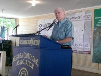 Transportation Commissioner Dick Hall speaks at the Neshoba County Fair.