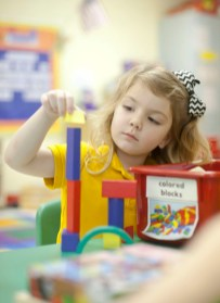 A preschool student works with blocks at Charleston Elementary.