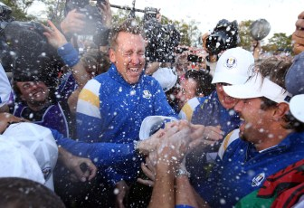 Ian Poulter, center, celebrates The 2014 Ryder Cup victory with Europe team members at Gleneagles, Scotland.