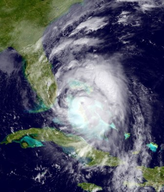 Satellite image provided by the National Oceanic and Atmospheric Administration shows Hurricane Matthew moving northwest of Cuba towards the Atlantic coast of southern Florida, Wednesday, Oct. 6, 2016.