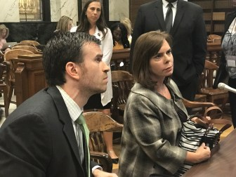 Kristi Plotner and Seth Shannon of Child Protective Services answer questions after their department's budget hearing Wednesday.