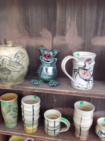 Commemorative mugs by the family of Peter Anderson are a favorite collectible among festival attendees.