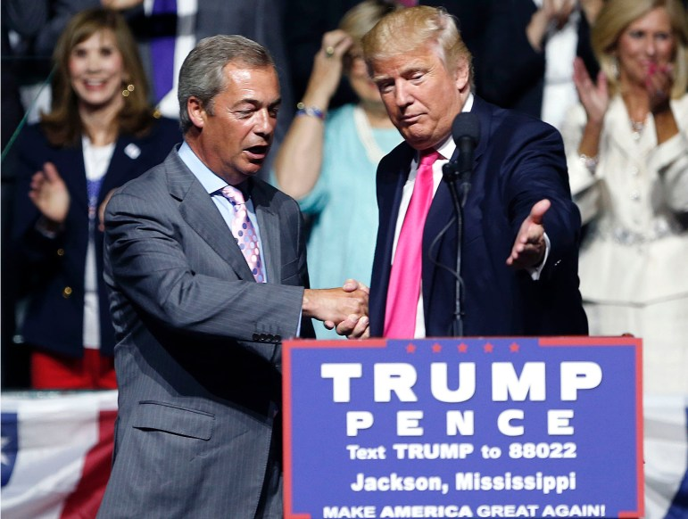 Republican presidential candidate Donald Trump, right, welcomes pro-Brexit British politician Nigel Farage, to speak at a campaign rally in Jackson on Aug. 24.