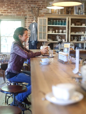 College student Shelby Morace enjoys a caramel frappe at Steampunk Coffee Roasters in Natchez recently.