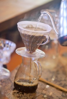 Steampunk Coffee Roasters barista Robert Williams pours steaming water through a roast at the espresso bar in Natchez.