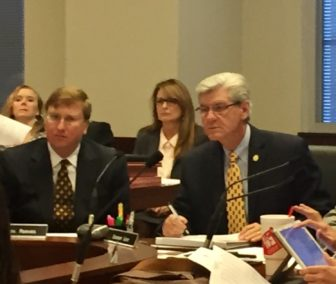 Lt. Gov. Tate Reeves, left, and Gov. Phil Bryant listen to state economists discuss revenue projections for FY17 and FY18.