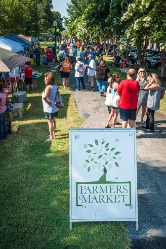Cleveland residents enjoy the Cleveland Farmers' Market, where Big River Bagels made their debut this summer.