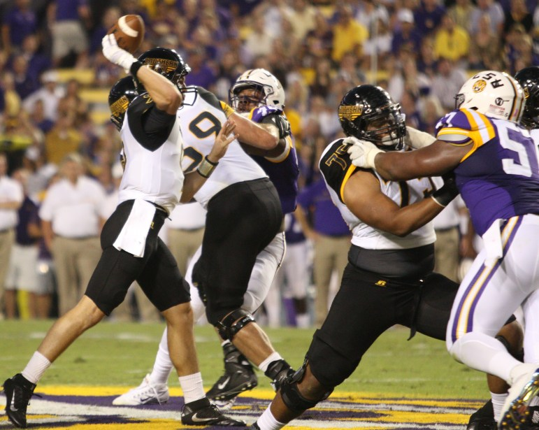 Nick Mullens, wearing a glove to protect stitched thumb, delivers a pass against LSU.