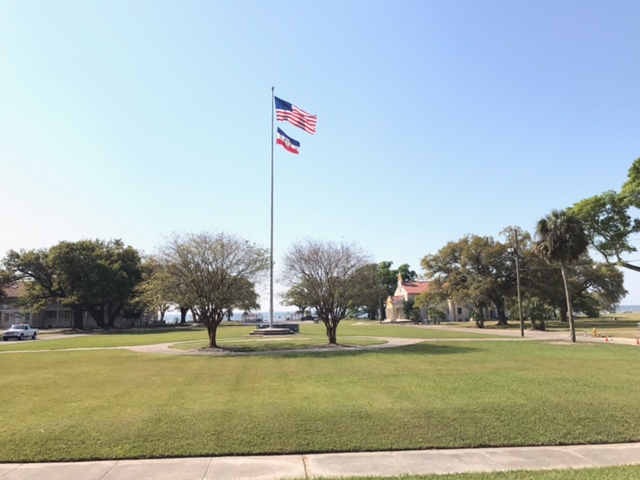 An American flag and the Mississippi bicentennial banner fly in Gulfport's Centennial Plaza.