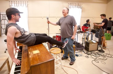 "Actor Ian Fairlee, as Jerry Lee Lewis on the piano, and actor Joseph Frost, playing the role of record producer Sam Phillips, share a laugh during rehearsals for ""Million Dollar Quartet"" at New Stage Theatre."