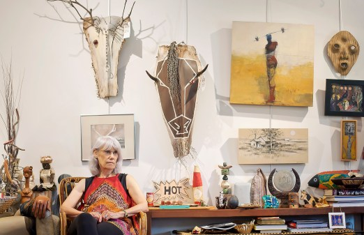 Lesley Silver poses with several art pieces that will be on display for The Attic Gallery's summer solstice open house June 21.