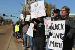 "Protesters chant ""dump Trump"" ahead of President Donald Trump's visit on Dec. 9, 2017"