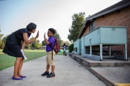 Amanda Johnson, the executive director of Clarksdale Collegiate Public Charter School, gives Aiden Tyson, 7, a high-five on the first day of school Wednesday July, 25, 2018. The school will start will 50 students in grades kindergarten through second. The school plans to have students up to 8th grade.