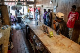 Customers wait for food inside of the Big Apple Inn in the 500 block of Farish Street in Jackson Friday, June 29, 2018.
