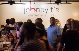Patrons enjoy the night life at Johnny T's Bistro on North Farish Street in Jackson Friday, July 6, 2018.
