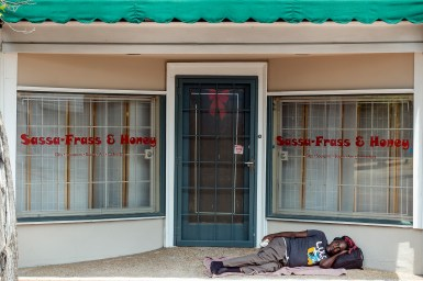 A man sleeps in the 300 block of Farish Street in Jackson Wednesday, June 27, 2018.