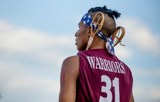 """Trey Ben watches as his team competes in the World Series of Stickball during the Choctaw Indian Fair at Choctaw Central High School Wednesday, July 11, 2018. The commissioner of the World Series of Stickball calls it """"the granddaddy of all American Sports."""""""