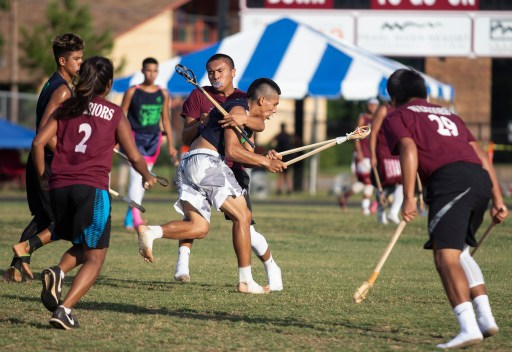 A player is tackled during the World Series of Stickball at the Choctaw Indian Fair in Choctaw Wednesday, July 11, 2018.