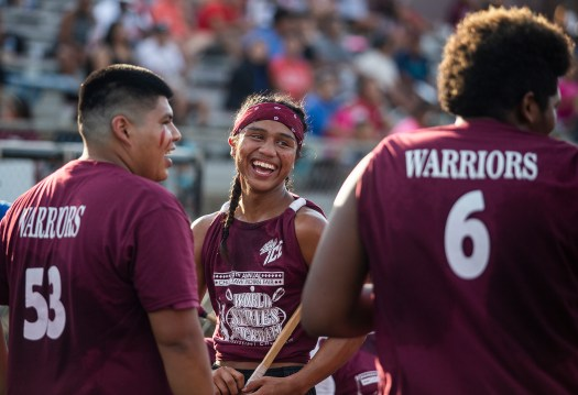 Players share a laugh during the World Series of Stickball at the Choctaw Indian Fair in Choctaw Wednesday, July 11, 2018.