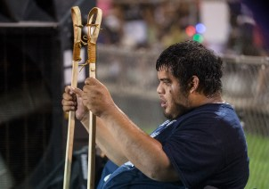 A player rests on the sideline during the World Series of Stickball at the Choctaw Indian Fair in Choctaw Wednesday, July 11, 2018.