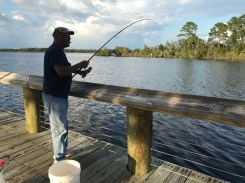 Vern Smith of Gautier catching a fish in Moss Point.
