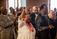 Audience members applaud and lift their hands in praise as Rev. William Barber II speaks during a Poor People's Campaign event at Greater Mt. Calvary Baptist Church Wednesday, October 24 in Jackson.