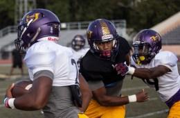 Hattiesburg High School quarterback Jarod Conner tries to get around the defense during practice Wednesday, October 11, 2018.