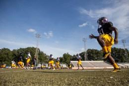 Hattiesburg High School football players warm up during practice Wednesday, October 11, 2018.