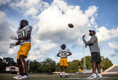 Hattiesburg High football coach Tony Vance throws a pass to Zhiari Williams during practice Wednesday, October 11, 2018. Vance, the school's fourth football coach in four years, lead the Tigers to a No. 1 ranking during the season.