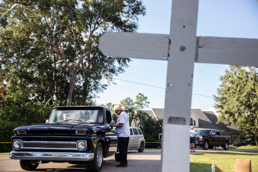 Father Paddy Mockler, right, blesses a classic truck during the Blessing of the Classics in the 22nd Annual Cruisin' The Coast event on the Diamondhead Wednesday, October 3, 2018.