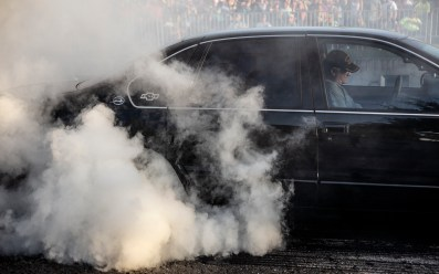 A competitor does a burnout in the Burn 'em Up in the Pass competition during the the 22nd Annual Cruisin' The Coast event in Pass Christian Thursday, October 4, 2018.