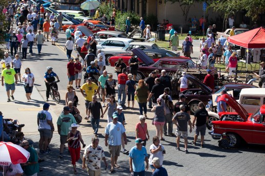 Car enthusiasts look at classic cars during the Biloxi Block Party in the 22nd Annual Cruisin' The Coast event on the Gulf Coast Wednesday, October 3, 2018.