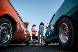 Brenda Hyde, left, talks to Sara Bibeau about her partner's 1966 Chevrolet Chevelle, right, during the Blessing of the Classics in the 22nd Annual Cruisin' The Coast event in Diamondhead Wednesday, October 3, 2018.