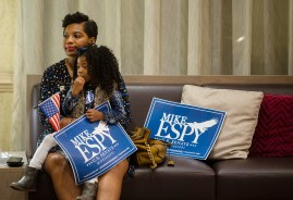 Candace Washington holds her 3-year-old daughter, Reagan Washington, during the Mike Espy watch party at the Hilton Jackson on County Line Road Tuesday, November 6, 2018.