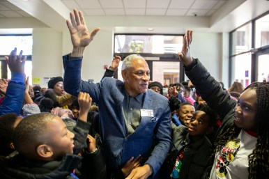 Students from Barack H. Obama Magnet School cheer for Mike Espy after he spoke to Millsaps College students during a town hall meeting Thursday, November 15, 2018.