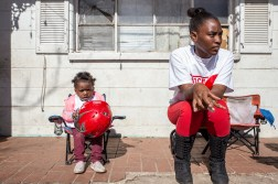 Roshunda Butler, right, sits with her cousin, 2-year-old Katelynn Jones, after protesting the death of George Robinson Monday, January 21, 2019.