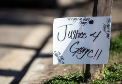 Signs in support of justice for George Robinson on Jones Avenue Monday, January 21, 2019.