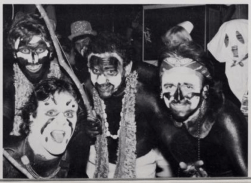 The 1983 University of Mississippi yearbook shows members of the Pi Kappa Alpha fraternity in face paint. One member on the right appears to be wearing a white robe. No caption or further explanation was published.