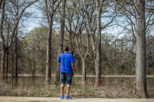 John Knight takes a photo of the flooding in Tchula during the Mississippi Chapter of Poor People's Campaign poverty tour Saturday, March 23, 2019.