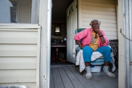 Geneva Williams sits on her porch in Tchula, Miss. Saturday, March 23, 2019. Residents in the Tchula, one of the poorest cities in the state, have been affected by the recent flooding in the Delta.