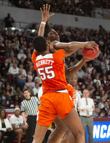 Mississippi State's Teaira McCowan (15) tries to get around Clemson's Tylar Bennett (55) during their game against Clemson at Humphrey Coliseum in Starkville, Miss., Sunday, March 24, 2019.